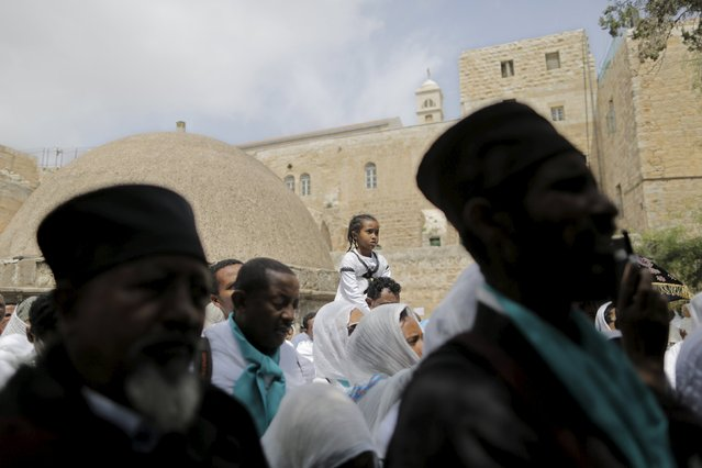 Ethiopian Orthodox worshippers attend the washing of the feet ceremony in the Ethiopian section of the Church of the Holy Sepulchre in Jerusalem's Old City April 9, 2015, ahead of Orthodox Easter. (Photo by Ammar Awad/Reuters)