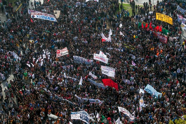 Protesters gather to march during a demonstration against the government to demand changes in the education system at Santiago, April 16, 2015. (Photo by Pablo Sanhueza/Reuters)
