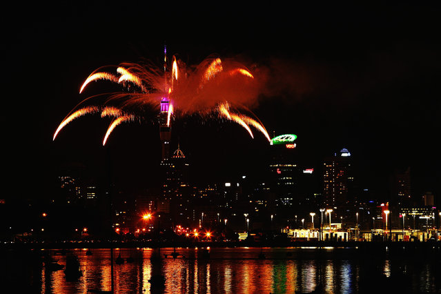 Fireworks are let off from the Auckland Sky Tower to celebrate the new year on January 1, 2014 in Auckland, New Zealand. (Photo by Hannah Johnston/Getty Images)