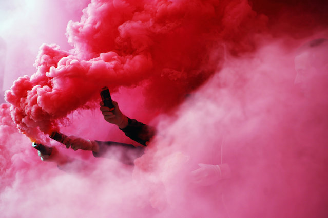 Fans of Stuttgart burn flares prior to the Bundesliga match between VfB Stuttgart and SV Werder Bremen at Mercedes-Benz Arena on April 12, 2015 in Stuttgart, Germany. (Photo by Alex Grimm/Bongarts/Getty Images)