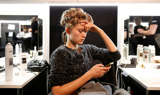 A model waits to get her makeup done for the Maybelline New York show ahead of the Berlin Fashion Week Autumn/Winter 2017 in Berlin, Germany, January 16, 2017. (Photo by Fabrizio Bensch/Reuters)