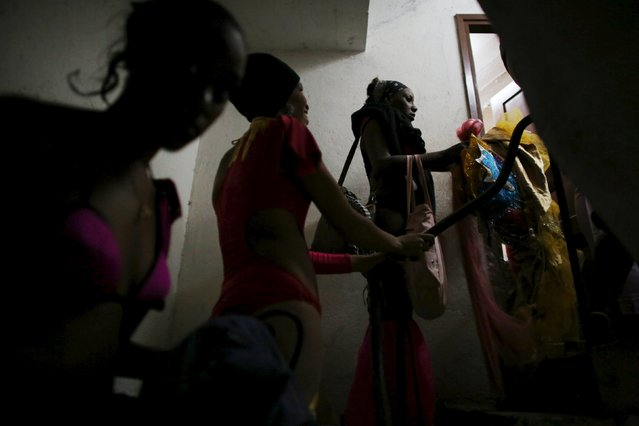 """Dancers are seen at the backstage of a cinema where the """"Cuerda Viva"""" (Live Strings) alternative music festival is taking place, in Havana, February 26, 2016. (Photo by Alexandre Meneghini/Reuters)"""