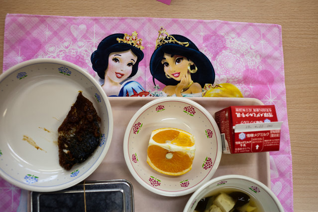 Lunch at the school one day included grilled fish, rice and soup with tofu, bamboo shoots and mountain asparagus. (Photo by Ko Sasaki/The Washington Post)
