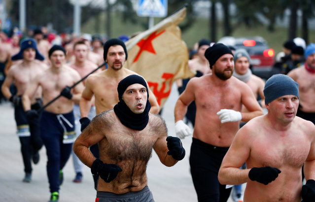"""Men take part in """"Real men's race"""" to mark the Defender of the Fatherland Day in Minsk, Belarus on February 23, 2019. (Photo by Vasily Fedosenko/Reuters)"""