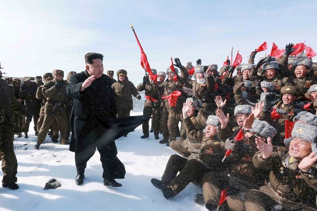 North Korean leader Kim Jong Un greets Korean People's Army pilots during a visit to the summit of Mt Paektu April 18, 2015, in this photo released by North Korea's Korean Central News Agency (KCNA) on April 19, 2015. (Photo by Reuters/KCNA)