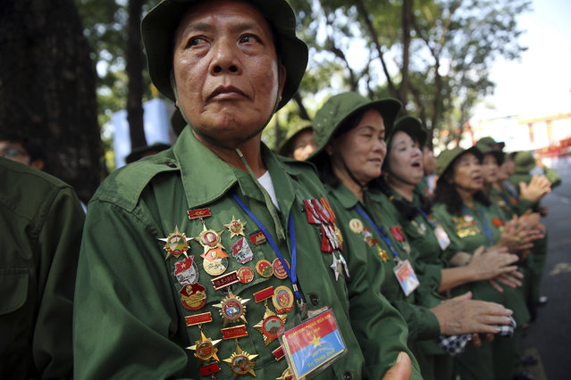 Vietnamese veterans gather for a parade celebrating the 40th anniversary of the end of the Vietnam War which is also remembered as the fall of Saigon, in Ho Chi Minh City, Vietnam, Thursday, April 30, 2015. (Photo by Na Son Nguyen/AP Photo)