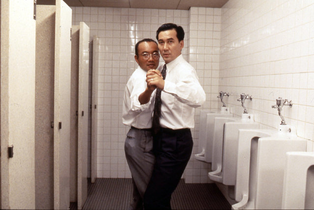 "This image provided by 1996KADOKAWA CORPORATION NHN shows Koji Yakusho, right, in a scene from ""Shall We Dance?"". Yakusho has played a range of roles in Japanese films and Hollywood offerings like ""Babel"" and ""Memoirs of a Geisha"". And he's being honored at the upcoming Tokyo International Film Festival. (Photo by KADOKAWA CORPORATION NHN via AP Photo)"