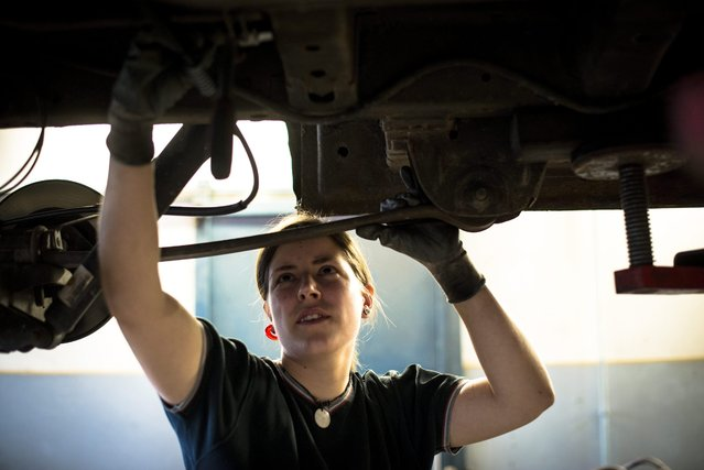Car mechanic Adrienn Jandzso works in the repair workshop of the Veszprem Department of the National Ambulance Service in Veszprem, 108 kms southwest of Budapest, Hungary, 25 February 2016. (Photo by Bea Kallos/EPA)