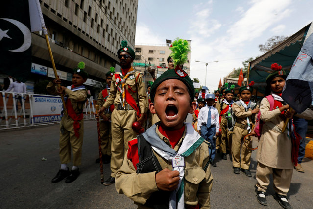 A Pakistani scout member reacts as he takes part in a march to commemorate the World Civil Defence Day in Karachi, Pakistan March 1, 2019. (Photo by Akhtar Soomro/Reuters)