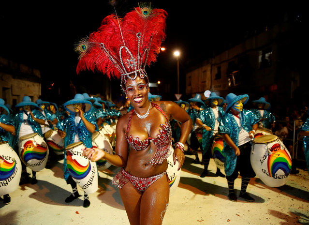 Members of a comparsa, a Uruguayan carnival group, dance during the Llamadas parade, a street fiesta with traditional Afro-Uruguayan roots in Montevideo February 9, 2017. (Photo by Andres Stapff/Reuters)