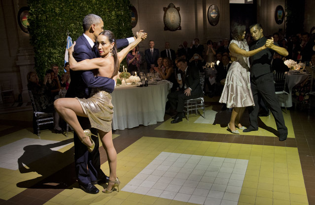 President Barack Obama and first lady Michelle Obama dance the tango with tango dancers during the State Dinner at the Centro Cultural Kirchner, Wednesday, March 23, 2016, in Buenos Aires, Argentina. (Photo by Pablo Martinez Monsivais/AP Photo)