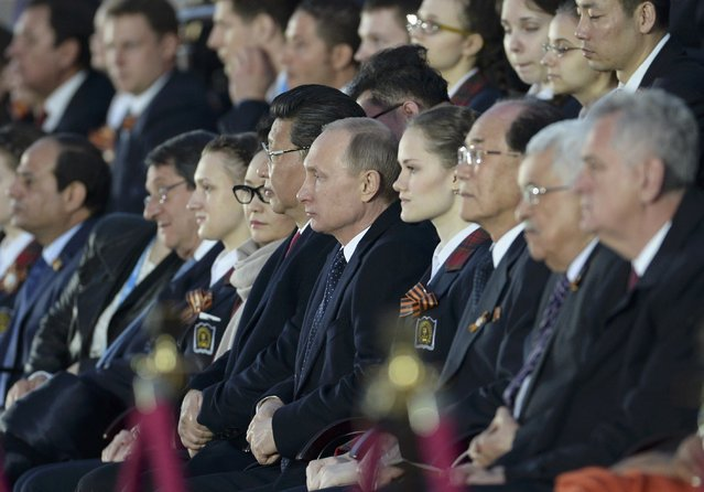 Russia's President Vladimir Putin (C) watches a festive concert marking the 70th anniversary of the end of World War Two in Europe, next to China's President Xi Jinping at Red Square in Moscow, Russia, May 9, 2015. (Photo by Reuters/Host Photo Agency/RIA Novosti)
