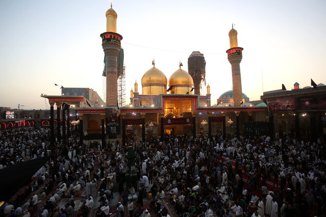 Shiite pilgrims pray at the Imam Moussa al-Kazim shrine to commemorate his death, in the Shiite district of Kazimiyah, Baghdad, Iraq, Wednesday, May 13, 2015. (Photo by Karim Kadim/AP Photo)