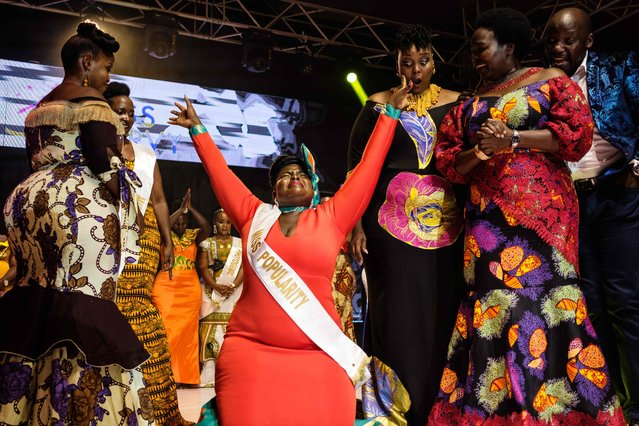 Nasasi Belinda, a buisness woman, reacts as she is crowned Miss Curvy Uganda in Kampala on April 26, 2019. The new pageant aims to celebrate African beauty and plus-size models. (Photo by Sumy Sadurni/AFP Photo)