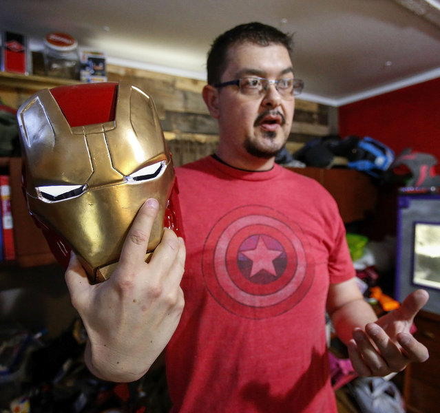 In this photo taken April 8, 2015, Clay Hielscher of Overbrook, Kan., holds the helmet of his Iron Man costume that he built using a resin kit. (Photo by Chris Neal/AP Photo/The Topeka Capital-Journal)