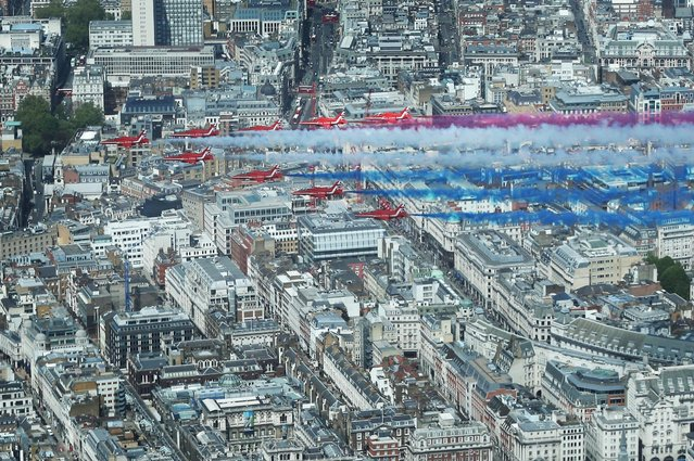 The Royal Air Force Red Arrows fly in formation over London for VE Day commemorations on May 10, 2015 in England. The 70th anniversary of Victory in Europe, when World War II ended in 1945,  is being commemorated with services and parades. Queen Elizabeth II attended a service of thanksgiving at Westminster Abbey. (Photo by Peter Macdiarmid/Getty Images/WPA Pool)