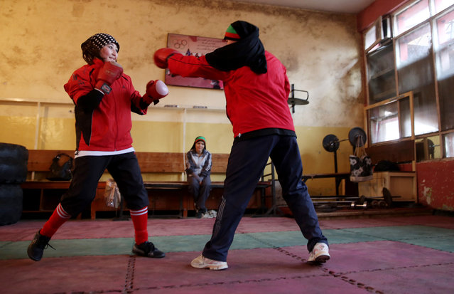 In this Wednesday, March, 5, 2014 photo, Afghan female boxers practice at the Kabul Stadium boxing club, Afghanistan. The women, who are 18 and older, don't have much more than determination, and a trainer who runs them through their paces, watches as they spar, corrects their technique, tells them when to jab, how to protect themselves, when to power through with a left and then a right. (Photo by Massoud Hossaini/AP Photo)