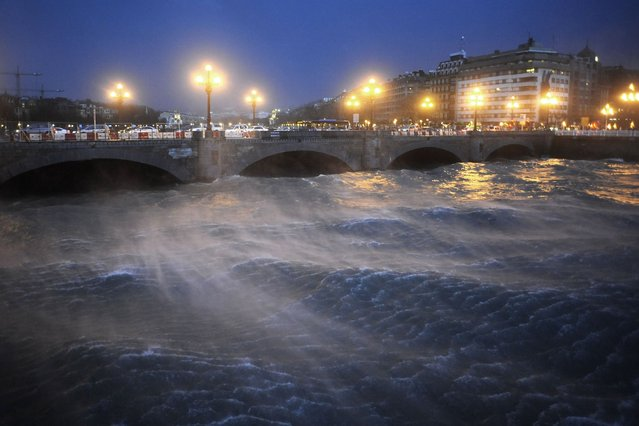 A picture taken on March 3, 2014 shows a bridge in the center of San Sebastian, northern Spain. Alerts have been issued in several regions of Spain for strong winds, heavy snowfall, avalanches and dangerous waves along the Atlantic coast. (Photo by Ander Gillenea/AFP Photo)