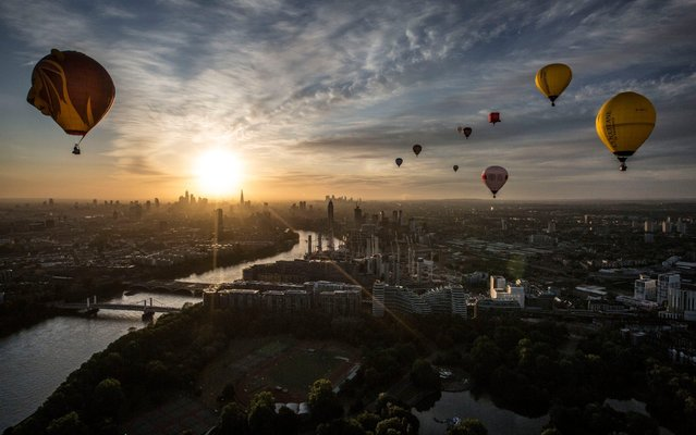 Hot air balloons fly over London as a part of the Lord Mayor's Hot Air Balloon Regatta, in London, June 9, 2019. (Photo by Jeff Gilbert/The Telegraph)