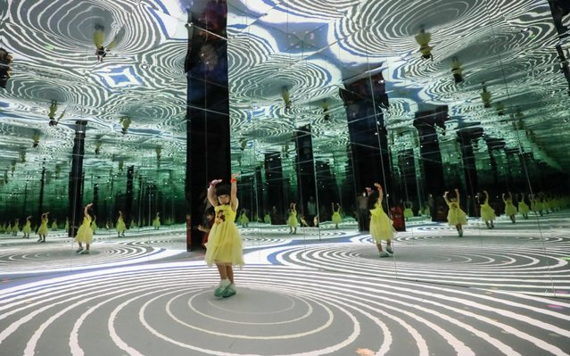 """A child views an immersive digital art exhibition """"Alice – The Return to Wonderland"""" at the Oriental Pearl TV Tower in Shanghai, China on July 4, 2019. (Photo by Ke Yi/Imaginechina/Sipa USA)"""