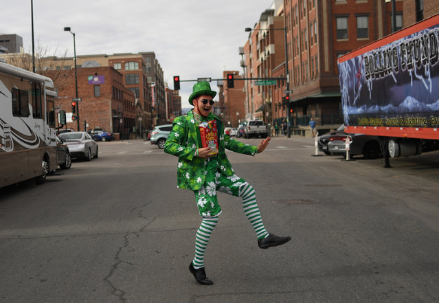 Gabe Alvarado, dancing on Blake Street, is dressed as Lucky, form the Lucky Charms cereal box, attends the 12th annual Keggs and Eggs event at Blake Street Tavern on March 17, 2017 in Denver, Colorado. (Photo by R.J. Sangosti/The Denver Post via Getty Images)