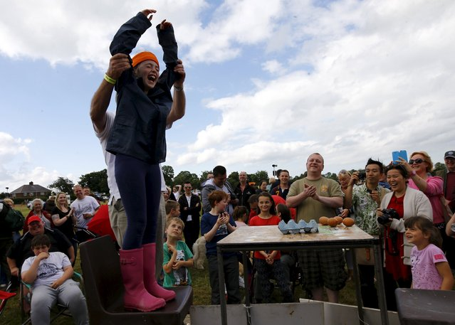 Anya Dawson, 8, celebrates after becoming the Russian Egg Roulette champion during the World Egg Throwing Championships and Vintage Day in Swaton, Britain June 28, 2015. (Photo by Darren Staples/Reuters)