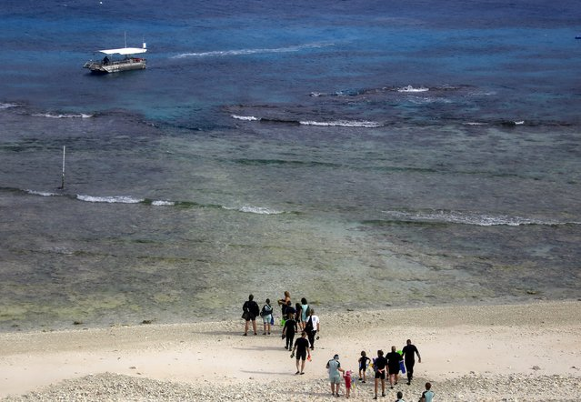 "Tourists prepare to board a boat to snorkel in an area called the ""Coral Gardens"" located at Lady Elliot Island, north-east of the town of Bundaberg in Queensland, Australia, June 10, 2015. (Photo by David Gray/Reuters)"