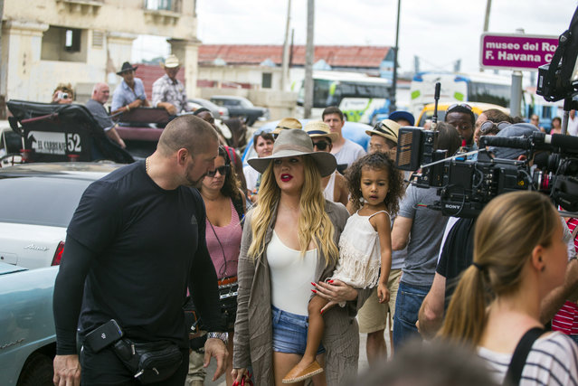 American entrepreneur and television personality Khloe Kardashian Odom holds a child, as she prepares to enter the Havana Club Rum Museum in Havana, Cuba, Wednesday, May 4, 2016. Khloe and the rest of the Kardashian clan are some of the famous entertainment figures to visit the island, since the declaration of detente with the U.S. in December 2014. (Photo by Desmond Boylan/AP Photo)