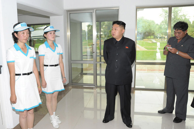 North Korean leader Kim Jong-Un (C) visits a building at a mini-golf course at the Rungna People's Pleasure Ground, which is nearing completion, in this undated picture released by the North's KCNA in Pyongyang on July 25, 2012. (Photo by Reuters/KCNA)