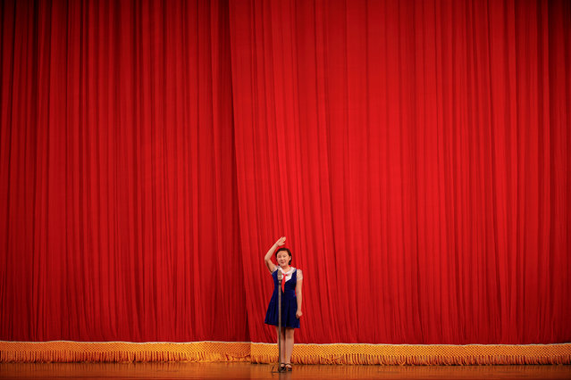 "A girl salutes to visitors before a show at the Mangyongdae Children's Palace in central Pyongyang, North Korea May 5, 2016. Foreign journalists invited to cover North Korea's first ruling party congress in 36 years were treated on Thursday to song and dance performances by schoolchildren professing their love for leader Kim Jong Un. Kim is expected to use the congress starting on Friday to declare North Korea a nuclear weapons state and formally adopt his ""Byongjin"" policy to pursue economic development and nuclear capability at the same time. (Photo by Damir Sagolj/Reuters)"