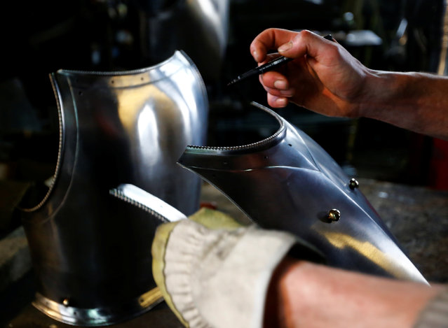 Blacksmith Johann Schmidberger works on a suit of armour for the Vatican's Swiss Guards at his workshop in Molln, Austria, March 29, 2017. (Photo by Leonhard Foeger/Reuters)