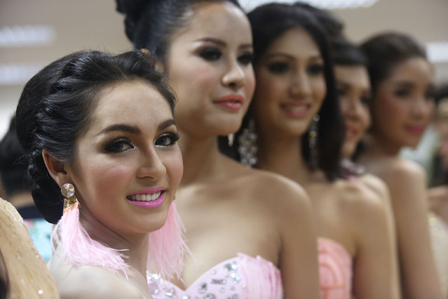 Contestants pose for pictures backstage before the Miss Tiffany's Universe transgender beauty contest on May 2, 2014 in Pattaya, Thailand. The Miss Tiffany's Universe contest has taken place annually in Pattaya since 2004 and is broadcast live on Thai national television. (Photo by Taylor Weidman/Getty Images)