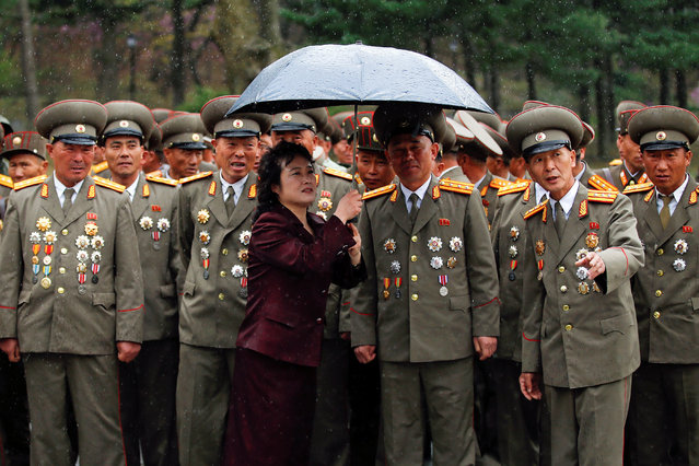Rain falls as military officers visit the birthplace of North Korean founder Kim Il Sung, a day before the 105th anniversary of his birth, in Mangyongdae, just outside Pyongyang, North Korea April 14, 2017. (Photo by Damir Sagolj/Reuters)