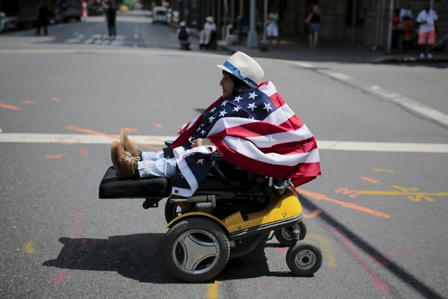 Clara Bailon, 36, suffering from Larsen syndrome arrives to take part in the disability pride parade in New York, July 12, 2015. (Photo by Eduardo Munoz/Reuters)