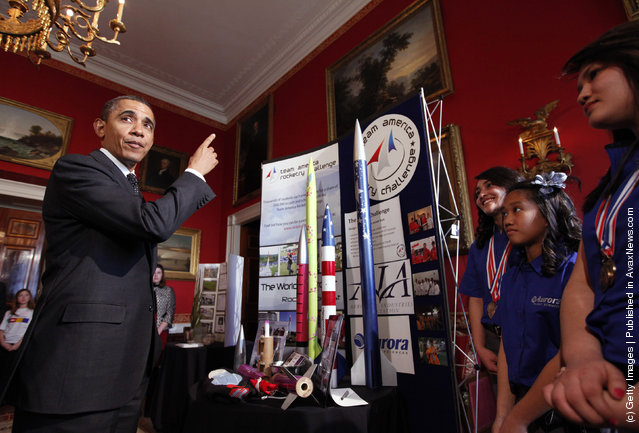 U.S. President Barack Obama talks with Ana Nieto (R) of Presidio, Texas, team leader of Team America Rocketry Challenge (TARC) along with teammates Janet Nieto (2nd L) and and Gwynelle Condino, while touring student science fair projects on exhibit in the State Dining Room at the White House