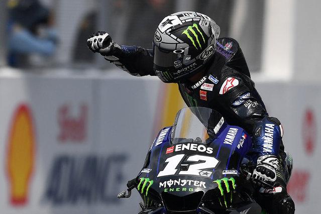 Monster Energy Yamaha's Spanish rider Maverick Vinales celebrates his victory in the MotoGP-class Malaysian Grand Prix motorcycle race at the Sepang International Circuit in Sepang on November 3, 2019. (Photo by Mohd Rasfan/AFP Photo)