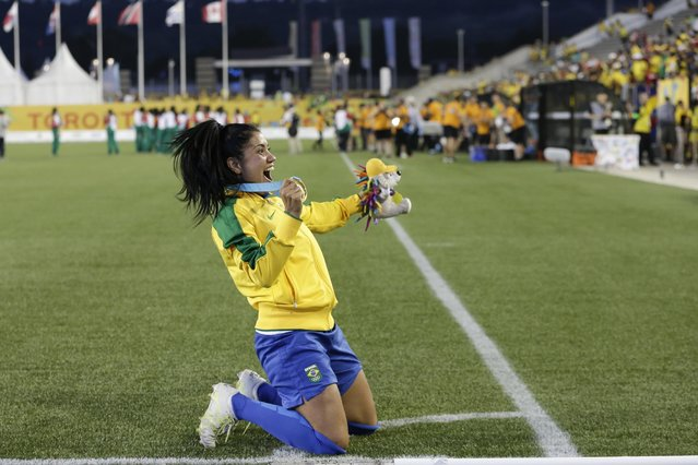 Brazil's Maurine Dorneles poses for photographers after winning the gold medal soccer game against Colombia in the Pan Am Games Saturday, July 25, 2015, in Hamilton, Ontario. (Photo by Gregory Bull/AP Photo)