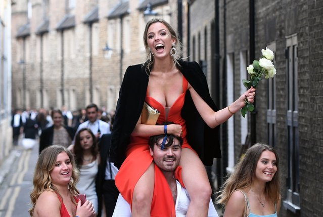 Students from Cambridge University make their way home along Trinity Lane after celebrating the end of the academic year at a May Ball in Trinity College on June 18, 2019. (Photo by Joe Giddens/PA Images via Getty Images)
