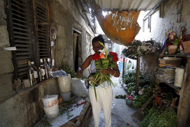 Barbara Herrera, a private flowers vendor stands inside her house in Havana April 11, 2015. (Photo by Reuters/Stringer)