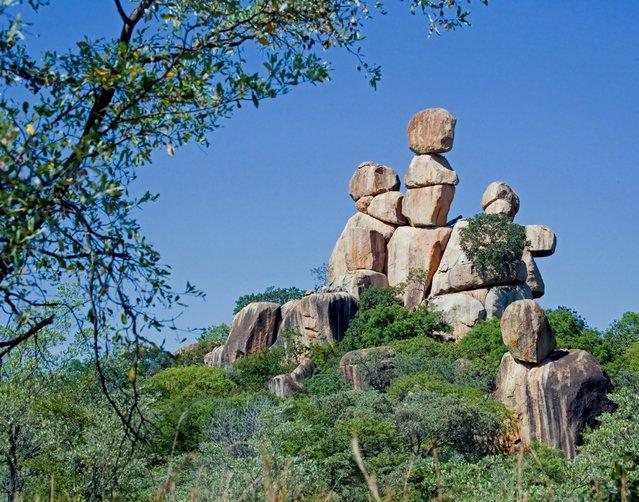 Mother and Child balancing Rocks in Matopos National Park, Zimbabwe