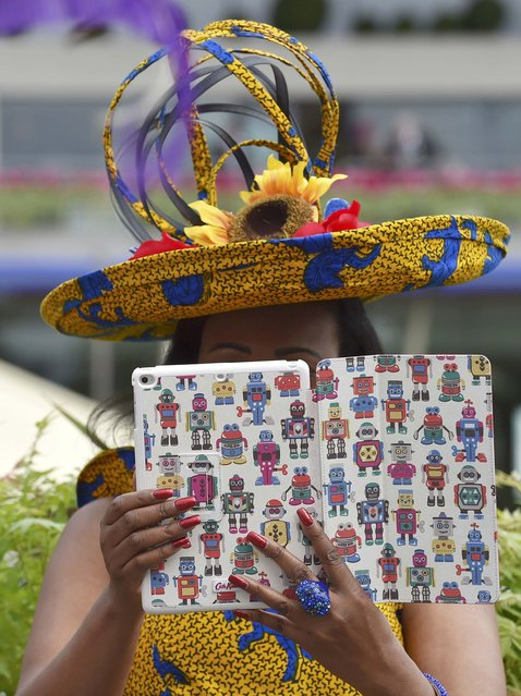 Britain Horse Racing, Royal Ascot, Ascot Racecourse on June 16, 2016. Ladies Day Racegoer uses tablet to take picture. (Photo by Toby Melville/Reuters)