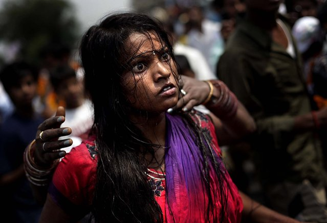 A devotee of Hindu goddess Maha Mariamman dances in trance during a religious procession in Amritsar, India on May 13, 2012