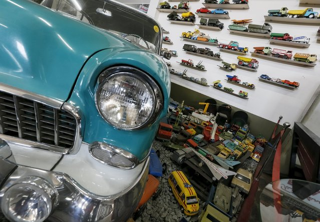 An old car and vehicle toys are seen at an exhibition at Phaeton museum in Zaporizhia, Ukraine, August 11, 2015. (Photo by Gleb Garanich/Reuters)