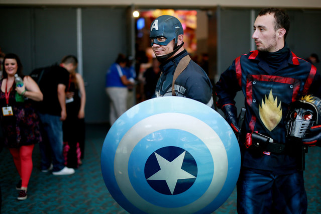 An attendee dressed as Captain America is seen during the 2014 Comic-Con International Convention in San Diego, California July 24, 2014. (Photo by Sandy Huffaker/Reuters)