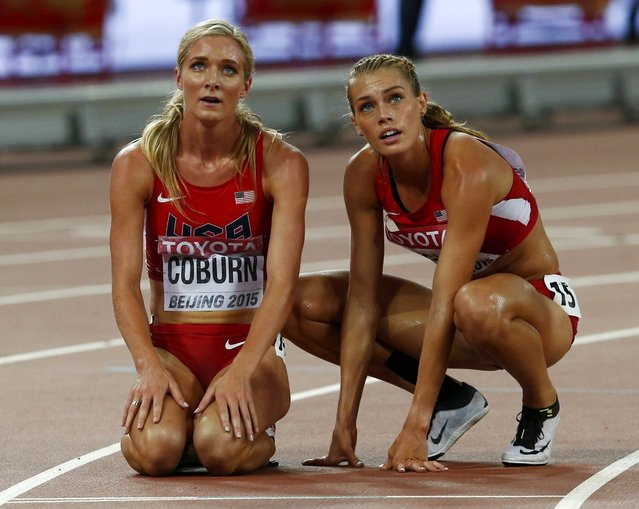 Emma Coburn (L) and Colleen Quigley of the U.S. look at the scoreboard after competing in the women's 3,000 metres steeplechase final during the 15th IAAF World Championships at the National Stadium in Beijing, China August 26, 2015. (Photo by David Gray/Reuters)