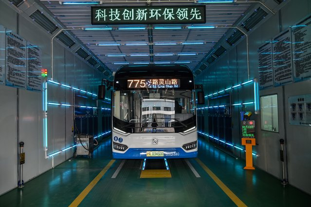 A bus is disinfected with ultraviolet rays as part of measures against of the COVID-19 coronavirus in Shanghai on March 12, 2020 (Photo by Hector Retamal/AFP Photo)