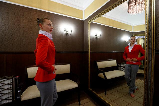 Belarussian rhythmic gymnast Melitina Staniouta tries on Belarus' Olympic team uniform in Minsk, May 27, 2016. (Photo by Vasily Fedosenko/Reuters)
