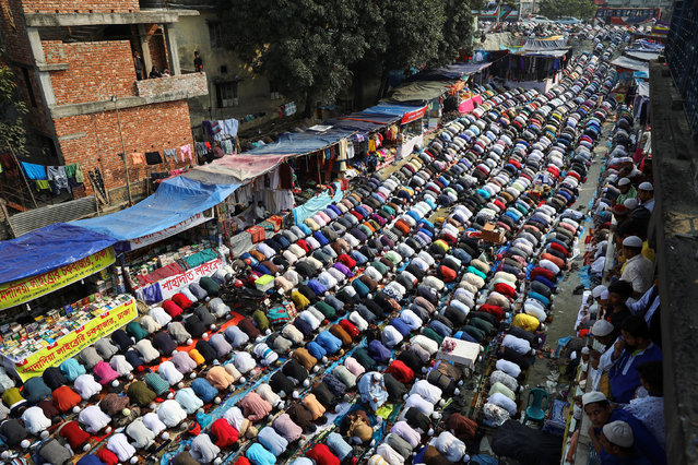 Muslims from around the world perform Friday prayer on the street during Bishwa Ijtema, which is considered the world's second-largest Muslim gathering after haj, in Tongi, on the outskirt of Dhaka, Bangladesh, January 10, 2020. (Photo by Mohammad Ponir Hossain/Reuters)