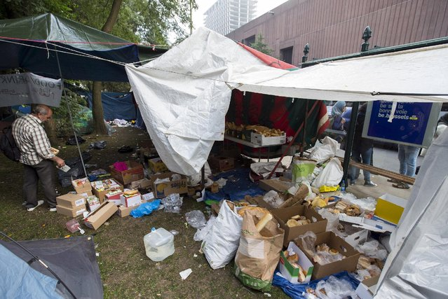 An asylum seeker collects some food in a makeshift camp outside the foreign office in Brussels, Belgium September 3, 2015. (Photo by Yves Herman/Reuters)