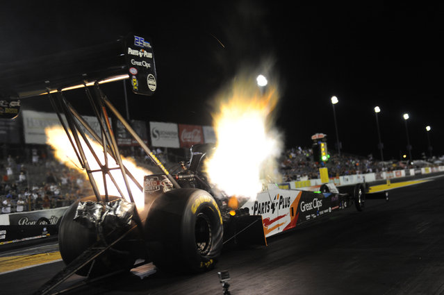 In this photo provided by the NHRA, Clay Millican drives during Top Fuel qualifying at the AAA Insurance NHRA Midwest Nationals drag races at Gateway Motorsports Park in Madison, Ill., Friday, September 29, 2017. (Photo by Teresa Long/NHRA via AP Photo)